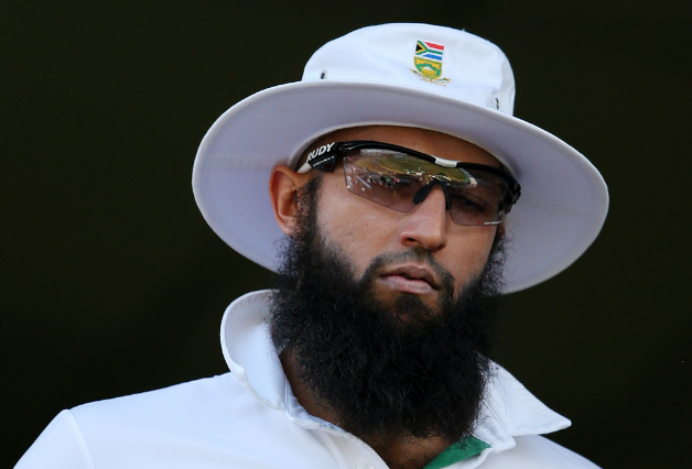 Hashim-Amla-of-South-Africa-takes-to-the-field-after-lunch-during-day-three-of-the-First-Test-33